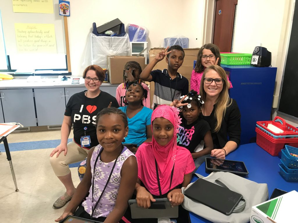 (group photo from left: Miss Kyla, Blessed, Taylor, Kabul, Abdigami, Destiny, Riley, and Mrs. Caroline)