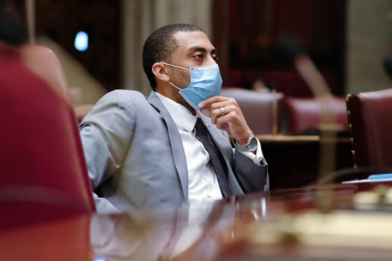 Jamaal Bailey sits with a mask on in the Senate chamber