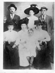 23John Jacob Franzen & FamilyKaren Fauls-TraynorOnondaga CountyThis is our 3rd great-grandfather, John Jacob Franzen and his family. He emigrated to the Syracuse in the 1850's with his parents, in part to avoid the mandatory military conscription required in Germany at that time, only to enlist for the US Civil War at the age of 17. He served in Company B of the 185th Infantry under Captain John Listman and Colonel Edwin Jenney. After the war, he would dress up in his uniform for parades and go visit the schools to tell them stories of the war. He worked for the Bendixen-Peck Cigar Company and was a member of the Cigar Makers Union. He is pictured here in 1907 with his wife and family members. From left to right, top row: John Jacob Franzen (with the cigar), his daughter Jessie Franzen, his son-in-law Humphrey Bush. Bottom row: His wife, Elizabeth (Libby) Smith Franzen, his daughter Julia Franzen Bush holding her son Donald and daughter Mary Elizabeth (Tibby) Franzen, who was our great-grandmother.