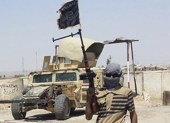 A fighter of the Islamic State of Iraq and the Levant (ISIL) stands guard at checkpoint near the city of Biji