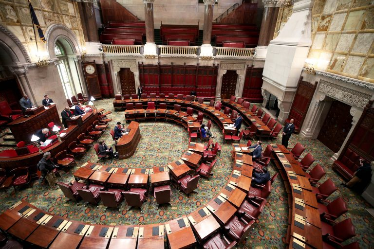 NYS Senate Session meets with a limited number of Senators and staff during the Covid-19 Pandemic. Usually during session the chamber is filled with Senators and staff. Because of social distancing and to prevent the spread of Covid-19, only the Majority and Minority Leaders and their deputies were in the chamber. They passed a bill that would grant paid leave for workers who must quarantine because of the coronavirus.     NY Senate Chamber, Capitol Building, Albany, NY     Photo Courtesy of NY Senate Media Services
