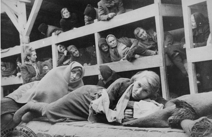 Women in the barracks of the newly liberated Auschwitz concentration camp.   Credit: US Holocaust Memorial Museum, courtesy of National Archives and Records Administration, College Park