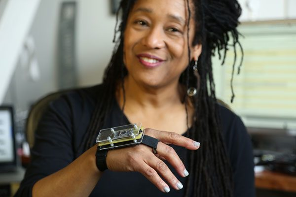 Pamela Z in her San Francisco Studio wearing a SensorPlay controller.  photo credit: Goran Vejvoda