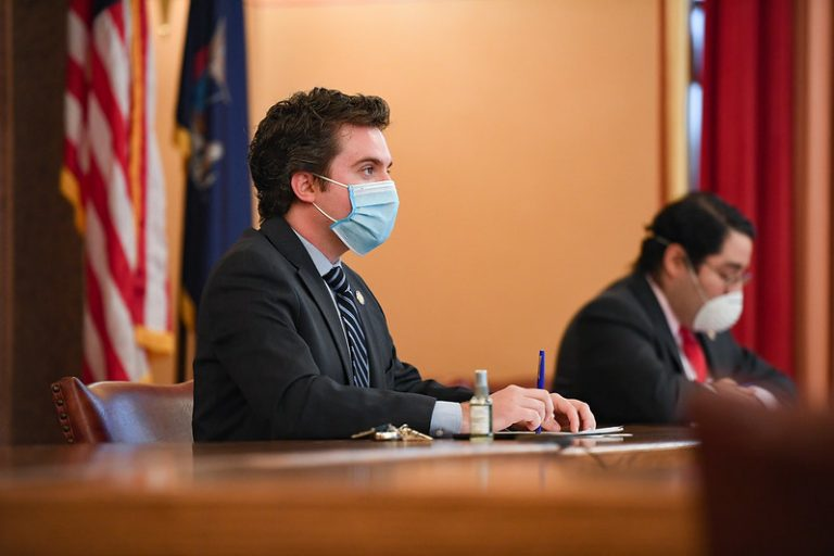 Senator James Skoufis attends committee hearing with mask on